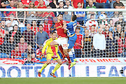 defender Jack Hobbs of Nottingham Forest jumps with Tomer Hemed of Brighton & Hove Albion during the Sky Bet Championship match between Brighton and Hove Albion and Nottingham Forest at The American Express Community Stadium, Brighton and Hove, England on 7 August 2015. Photo by Phil Duncan.