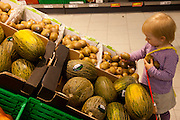 Astrid Holmann's daughter Lillith in Hamburg, Germany shopping in the Penny supermarket. They were photographed for the Hungry Planet: What I Eat project with a week's worth of food in June. Model Released.