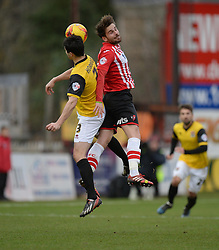 Exeter City's Arron Davies wins a high ball over Northampton's Evan Horwood - Photo mandatory by-line: Alex James/JMP - Mobile: 07966 386802 - 10/01/2015 - SPORT - football - Exeter - St James Park - Exeter City v Northampton - Sky Bet League Two