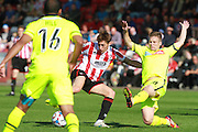 James Rowe and Jay Harris during the Vanarama National League match between Cheltenham Town and Tranmere Rovers at Whaddon Road, Cheltenham, England on 26 September 2015. Photo by Antony Thompson.