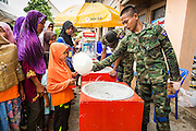 07 JULY 2013 - NARATHIWAT, NARATHIWAT, THAILAND:  A Royal Thai Marine makes cotton candy for Muslim civilians during a civil affairs program in Narathiwat. Royal Thai Marines in Narathiwat province held a special ceremony Sunday in advance of Ramadan. They presented widows, orphans and indigent people with extra rice and food as a part of the Thai government's outreach to resolve the Muslim insurgency that has wracked southern Thailand since 2004. The Holy Month of Ramadan starts on about July 9 this year. Muslims are expected to fast from dawn to dusk, engage in extra prayers, recitation of the Quran and perform extra acts of charity during Ramadan. It is the holiest month of the year for Muslims.   PHOTO BY JACK KURTZ