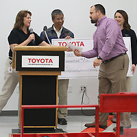 Lauren Wood | Buy at photos.djournal.com<br /> Saltillo High School teacher Jason Pannell receives a $1,000 gift for working with the students Thursday during the BEST robotics lunch at Toyota Motor Manufacturing Mississippi.