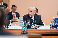 07 JUL 2017, HAMBURG/GERMANY:<br /> Donald Trump, Praesident Vereinigte Staatsn von America, USA, auf dem Weg durch den Sitzungssaal, 1. Arbeitssitzung, G20 Gipfel, Messe<br /> IMAGE: 20170707-01-012<br /> KEYWORDS: G20 Summit, Deutschland