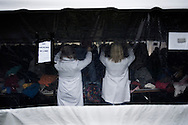 "OHIO, Toledo, October 27, 2012: Volunteers of the association  ""1Matters.org"" are seen as they setting up the tent of used clothing which was donated by the community for the homeless and people living below the poverty line . ALESSIO ROMENZI"
