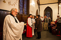 Rev. Marcus Crapsey and Bishop A. Robert Hirschfeld greet the congregation gathered for the final service Sunday afternoon at Trinity Episcopal Church in Tilton.  (Karen Bobotas/for the Laconia Daily Sun)
