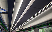 Pattern formed by stripes of ceiling lighting inside GWR InterCity Express train carriage, UK