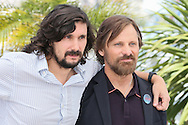 """CANNES, FRANCE - MAY 18:  Director Lisandro Alonso and actor Viggo Mortensen attend """"Jauja"""" photocall at the 67th Annual Cannes Film Festival on May 18, 2014 in Cannes, France.  (Photo by Tony Barson/FilmMagic)"""
