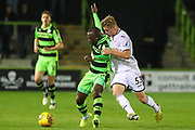 Swansea City's Adam King challenges Forest Green Rovers Drissa Traoré(4) during the EFL Trophy match between Forest Green Rovers and U21 Swansea City at the New Lawn, Forest Green, United Kingdom on 31 October 2017. Photo by Shane Healey.
