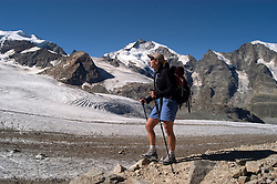 Switzlerland: Hiking the Swiss Glaciers near St. Moritz, taking the Diavolezza Morteratsch hike..Hikers at Pers Glacier.  Model released...Photo copyright Lee Foster, 510/549-2202, lee@fostertravel.com, www.fostertravel.com..Photo #: swisse11457