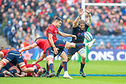 Ben Toolis (#4) of Edinburgh Rugby attempts to charge down a clearing kick by Connor Murray (#9) of Munster Rugby during the Heineken Champions Cup quarter-final match between Edinburgh Rugby and Munster Rugby at BT Murrayfield Stadium, Edinburgh, Scotland on 30 March 2019.