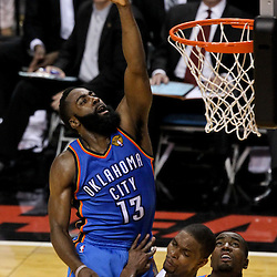 Jun 21, 2012; Miami, FL, USA; Oklahoma City Thunder guard James Harden (13) collides with Miami Heat power forward Chris Bosh (1) during the third quarter in game five in the 2012 NBA Finals at the American Airlines Arena. Mandatory Credit: Derick E. Hingle-US PRESSWIRE