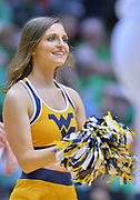 SAN DIEGO, CA - MARCH 18:  A West Virginia Mountaineers cheerleader performs during a second round game of the Men's NCAA Basketball Tournament against the Marshall Thundering Herd at Viejas Arena in San Diego, California. West Virginia won 94-71.  (Photo by Sam Wasson)