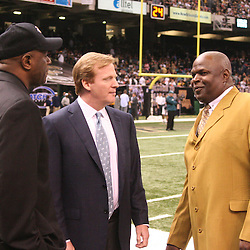 13 January 2007: NFL Commissioner Roger Goodell (center) talks with former New Orleans Saints linebackers Pat Swilling (L) and Rickey Jackosn (R) prior to kickoff of a 27-24 win by the New Orleans Saints over the Philadelphia Eagles in the NFC Divisional round playoff game at the Louisiana Superdome in New Orleans, LA. The win advanced the New Orleans Saints to the NFC Championship game for the first time in the franchise's history.