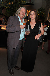 MARTIN MILLER and his wife IOANA at the unveiling of 'The Diamond Queen' a collaboration between Asprey and artist Chris Levine in aid of The Woodland Trust, held at Asprey, 167 New Bond Street, London on 28th May 2012.