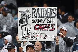 November 7, 2010; Oakland, CA, USA;  An Oakland Raiders fan holds a sign during the first quarter against the Kansas City Chiefs at Oakland-Alameda County Coliseum.