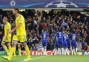 Chelsea celebrate Willian's first half opener during the Champions League match between Chelsea and Maccabi Tel Aviv at Stamford Bridge, London, England on 16 September 2015. Photo by Andy Walter.
