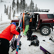 Heather and Jay Goodrich put their skins on at the top of Teton Pass near Wilson, Wyoming for a winter backcountry session.