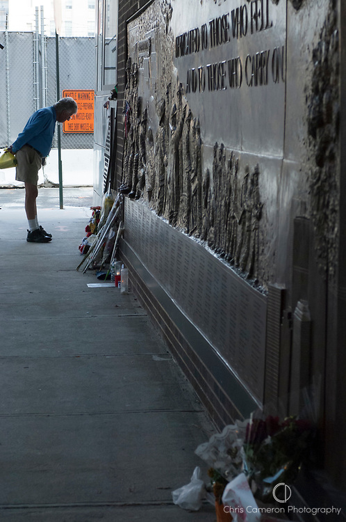 A man reads part of the monument to the dead from the fall of the twin Towers in the terrorist attack 911. Manhattan, New York