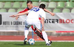 Ermin Rakovic of Interblock vs Bojan Dukic of Hit Gorica at 28th Round of Slovenian First League football match between NK Interblock and ND Hit Gorica ZAK Stadium, on April 11, 2009, in Ljubljana, Slovenia. Gorica won 2:1. (Photo by Vid Ponikvar / Sportida)