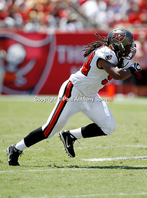 Tampa Bay Buccaneers defensive end Adrian Clayborn (94) chases the action during the NFL week 1 football game against the Detroit Lions on Sunday, September 11, 2011 in Tampa, Florida. The Lions won the game 27-20. ©Paul Anthony Spinelli