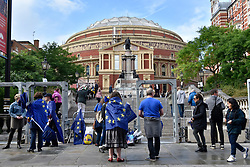 © Licensed to London News Pictures. 09/09/2017. London, UK. Classical music fans, many dressed up in elaborate costumes, gather outside the Royal Albert Hall ahead of The Last Night at the Proms.  A group called Thank EU for the Music brought thousands of European Union flags to hand out concert goers. Photo credit : Stephen Chung/LNP