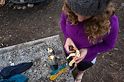 Sydney Kaufman makes breakfast while camping at the Redondo Campground, in the Santa Fe National Forest, near La Cueva, New Mexico, August 7, 2016. <br /> Photo by David Lienemann<br /> www.davidlienemann.com