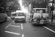 Police van driving through the protest,during the 2nd Criminal Justice March, Victoria, London, UK, 23rd of July 1994.