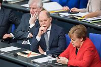 21 MAR 2019, BERLIN/GERMANY:<br /> Horst Seehofer (L), CSU, Bundesinnenminister, Olaf Scholz (M), SPD, Bundesfiananzminister, und Angela Merkel (R), CDU, Bundeskanzlerin, Bundestagsdebatte zur Regierungserklaerung der Bundeskanzlerin zum Europaeischen Rat, Plenum, Deutscher Bundestag<br /> IMAGE: 20190321-01-060