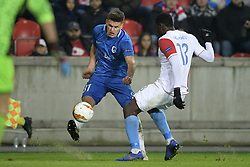 February 14, 2019 - Prague, CZECH REPUBLIC - Genk's Joakim Maehle Pedersen and Slavia's Michael Ngadeu-Ngadjui fight for the ball during a soccer game between Czech club SK Slavia Praha and Belgian team KRC Genk, the first leg of the 1/16 finals (round of 32) in the Europa League competition, Thursday 14 February 2019 in Prague, Czech Republic. BELGA PHOTO YORICK JANSENS (Credit Image: © Yorick Jansens/Belga via ZUMA Press)