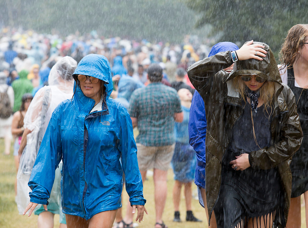 Festival attendees endure the pouring rain at Music Midtown, at Piedmont Park in Atlanta Sunday.