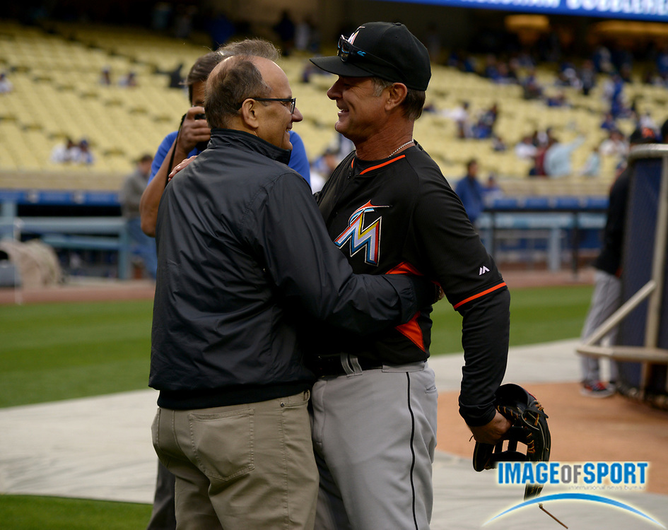 Apr 25, 2016; Los Angeles, CA, USA; Joe Torre (left) embraces Miami Marlins manager Don Mattingly (8) before a MLB game against the Los Angeles Dodgers at Dodger Stadium.