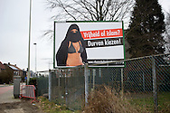 Extreme right political party Vlaams Belang starts their campaign for the local elections with a poster of a woman in bikini wearing a burqa. 'Freedom or Islam? Dare to choose' is their slogan and presents Islam as the biggest threath in their society for flemish voters. Aartselaar, Belgium, 2012