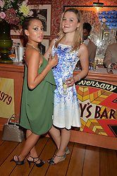 Left to right, LAUREN FAITH and AMBER ATHERTON at a party to celebrate 35 years of Harry's Bar, 26 South Audley Street, London on 19th September 2014.