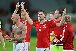 LILLE, FRANCE - Friday, July 1, 2016: Wales' Ben Davies celebrates the 3-1 victory against Belgium at full time after the UEFA Euro 2016 Championship Quarter-Final match at the Stade Pierre Mauroy. David Cotterill, goalkeeper Daniel Ward. (Pic by Paul Greenwood/Propaganda)