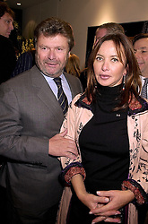MR & MRS ALAIN-DOMINIQUE PERRIN he is head of Cartier, at a party in London on 1st November 2000.OIP 132