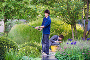 Last minute preparations continue at the No Man's land: ABF The Soldier's Charity garden. The Chelsea Flower Show 2014. The Royal Hospital, Chelsea, London, UK.  19 May 2014.  Guy Bell, 07771 786236, guy@gbphotos.com