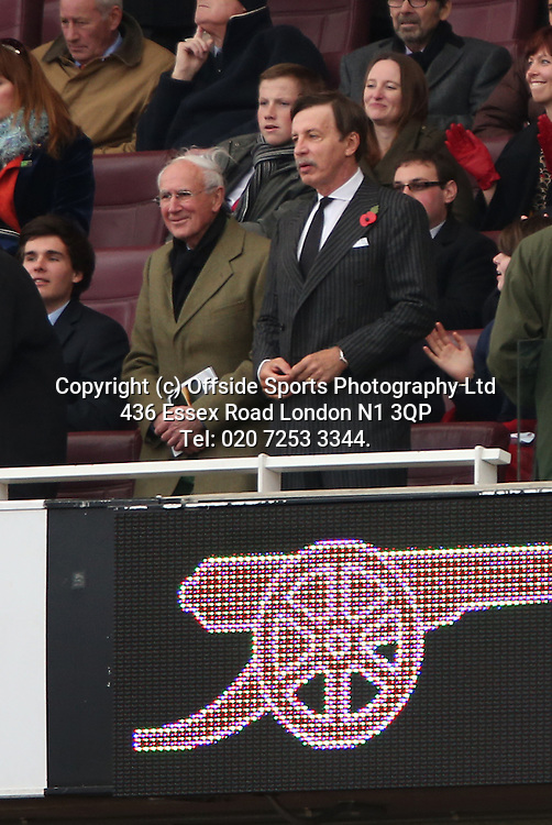 27 October 2012 Premeir League football. Arsenal v Queens Park Rangers.<br /> Arsenal owner Stan Kroenke wearing a poppy on his pin striped suit.<br /> Photo: Mark Leech.