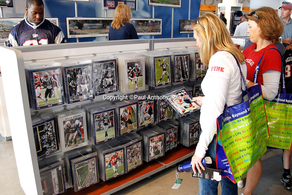Fans look at team licensed merchandise at the team store prior to the New England Patriots NFL regular season week 3 football game against the Buffalo Bills on September 26, 2010 in Foxborough, Massachusetts. The Patriots won the game 38-30. (©Paul Anthony Spinelli)