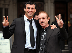 File photo dated 23-02-2009 of Undefeated world champion Joe Calzaghe (left) and father Enzo.