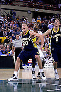 26 November 2005: MU's Steve Novak (20) blocks out USC forward Brandon Wallace in the Marquette Golden Eagle 92-89 overtime victory over the University of South Carolina Gamecocks to win the championship at the Great Alaska Shootout in Anchorage, Alaska.