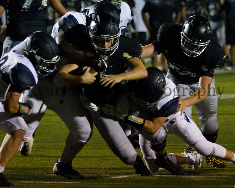 Ray-Pec quarterback Noah Durham dives forward for a few extra yards Friday night against Lee's Summit West at Panther Stadium. The Panthers struggled on offense in their 41-7 loss to LSW.