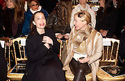 Kirsten Scott Thomas and Daphne Guinness, Valentino couture fashion sho,  rue Bonaparte, Paris, 21 January 2004. © Copyright Photograph by Dafydd Jones 66 Stockwell Park Rd. London SW9 0DA Tel 020 7733 0108 www.dafjones.com