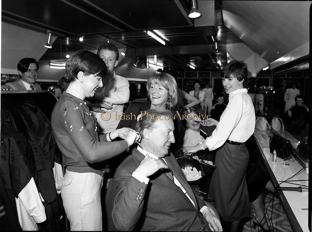 15/05/1982<br /> 05/15/1982<br /> 15 May 1982<br /> An Taoiseach, Mr Charles Haughey, canvasing with Fianna Fail bye-election candidate Eileen Lemass in Dublin West. The Taoiseach has his hair combed by Sandra Curley of Cabra in the Peter Mark Hairdressing Shop in the Superquinn Centre, Blanchardstown. Eileen Lemass beside hairdresser.