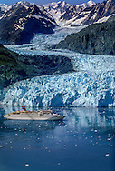 Aerial of cruiseship in front of Lamplough Glacier in Glacier Bay National Park and Preserve.