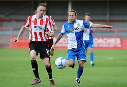 Stuart Sinclair of Bristol Rovers challenges Daniel Parslow of Cheltenham Town - Mandatory by-line: Neil Brookman/JMP - 25/07/2015 - SPORT - FOOTBALL - Cheltenham Town,England - Whaddon Road - Cheltenham Town v Bristol Rovers - Pre-Season Friendly