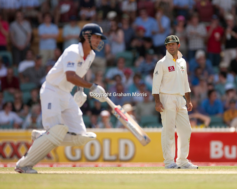 Captain Ricky Ponting watches Alastair Cook (left) run during the second Ashes Test Match between Australia and England at the Adelaide Oval. Photo: Graham Morris (Tel: +44(0)20 8969 4192 Email: sales@cricketpix.com) 4/12/10