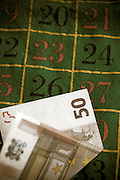 a 50 EUR note on a roulette table