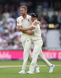 England's Stuart Broad (left) celebrates with Sam Curran during day three of the Second NatWest Test match at Headingley, Leeds.