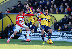 Oxford United's Danny Rose is challenged by Exeter City's Alex Nicholls  - Photo mandatory by-line: Neil Brookman/JMP - Mobile: 07966 386802 - 24/01/2015 - SPORT - Football - Oxford - Kassam Stadium - Oxford United v Exeter City - Sky Bet League Two
