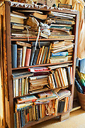 Bookshelf stuffed with old books